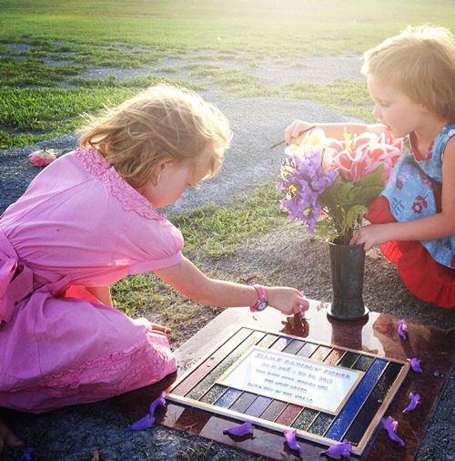 Brioni and Calista decorating Elijah's grave, November 2012