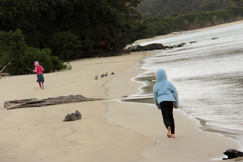 Brioni and Aisha walking along the beach at Cockle Creek, Recherche Bay, Tasmania, January 2013