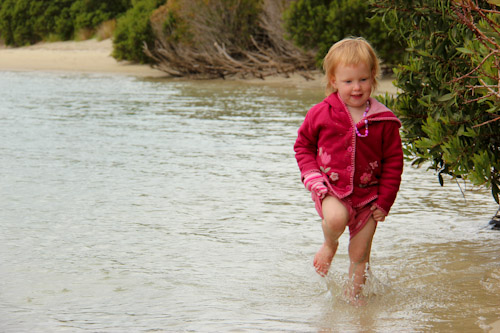 Delaney wading through the water at Cockle Creek, Recherche Bay, Tasmania, January 2013