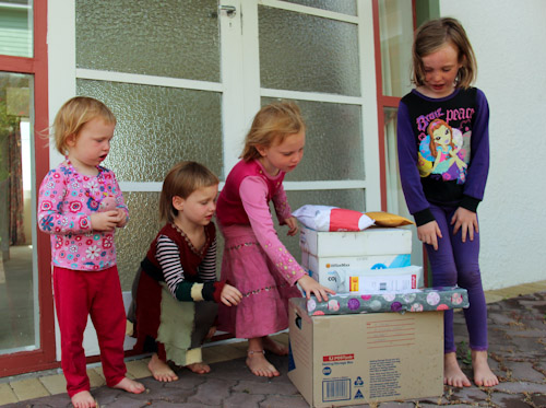 Our girls in front of pile of parcels, January 2013