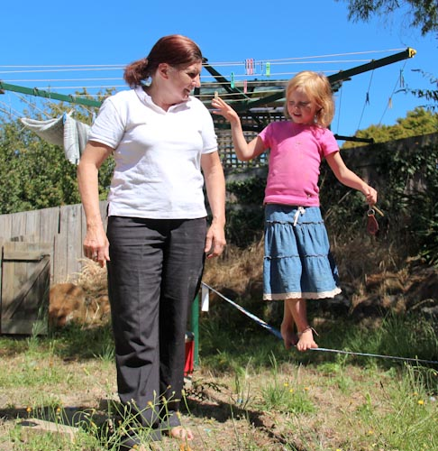 Yvonne helping Brioni walk the slackline, January 2013