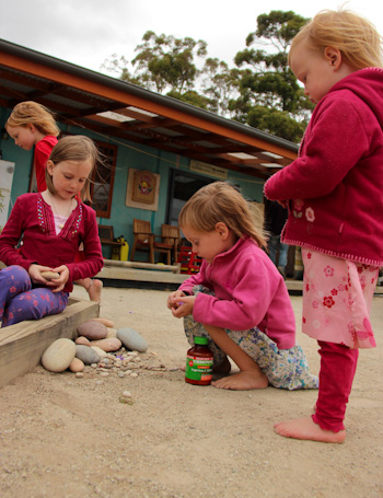 Our girls playing with rocks, January 2013