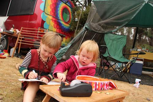 Calista and Delaney drawing and colouring at camp, Tasmanian Circus Festival, January 2013