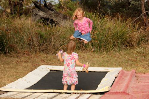 Jumping on a trampoline at Fractangular, Buckland, Tasmania, February 2013