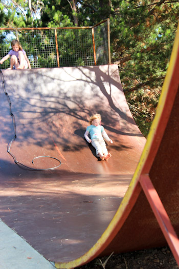 Playing on a skateboard ramp, Poatina, February 2013