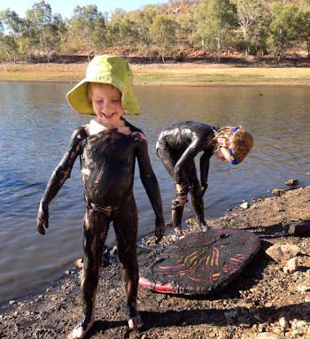 Playing with mud on the banks of Lake Moonderra, Mount Isa, Queensland, August 2013