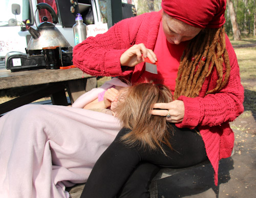 Lauren looking for nits in Calista's hair, August 2014