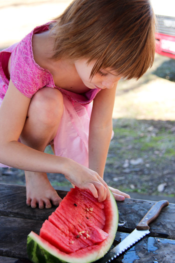 Calista choosing a piece of watermelon, August 2014